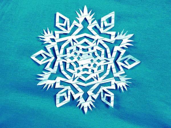 Красивые снежинки из бумаги фото 6